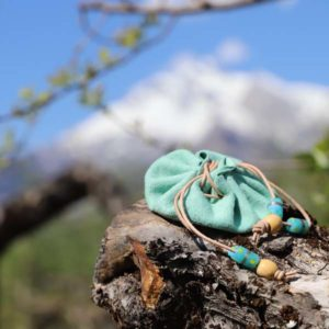bourse en cuire turquoise-perles